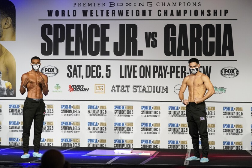 Errol Spence Jr., left, and Danny Garcia pose on stage after their weigh-ins Friday.