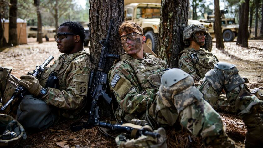 In this March 22, 2017 photo, Pfc. Jacob Alger, middle, Spc. Shalaire Johnson, left, and Pfc. Haley