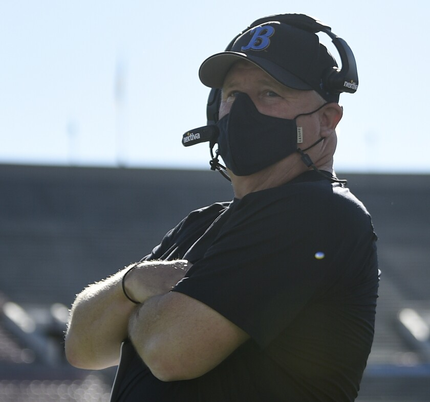 UCLA coach Chip Kelly stands on the sidelines during the Bruins' game against California.
