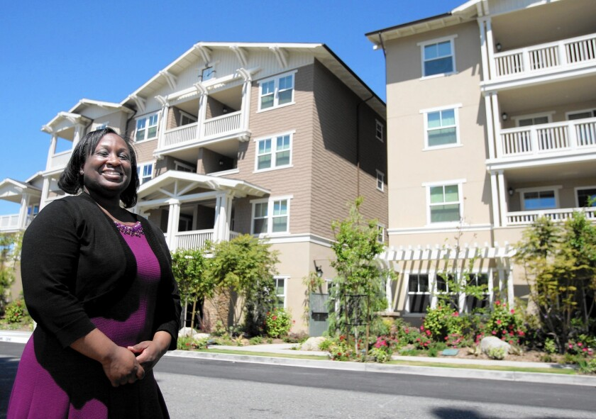 Former homeless U.S. Navy veteran Yolanda Franklin, 39, is all smiles now that she has a place to call her own at the newly-opened Veterans Village of Glendale.
