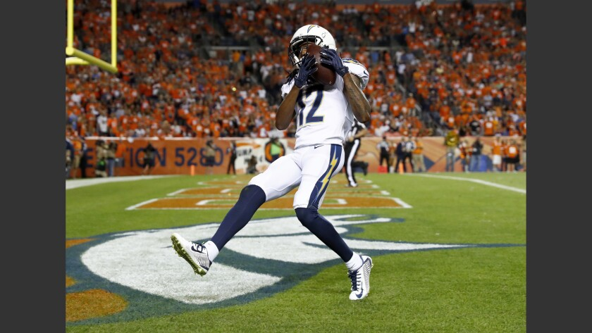 Chargers wide receiver Travis Benjamin runs with the ball during a game against the Cleveland Browns in December 2017.
