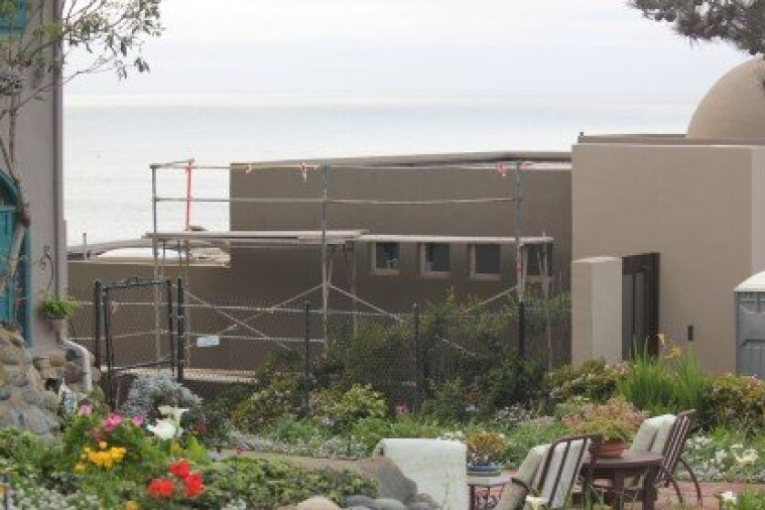 The California Coastal Commission is determining whether recent work on this bluff-top home at the foot of Princess Street violates the terms of an agreement it entered into with the property owner last summer.  Courtesy
