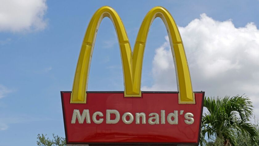 McDonald's in Canada will offer children's books with Happy Meals.