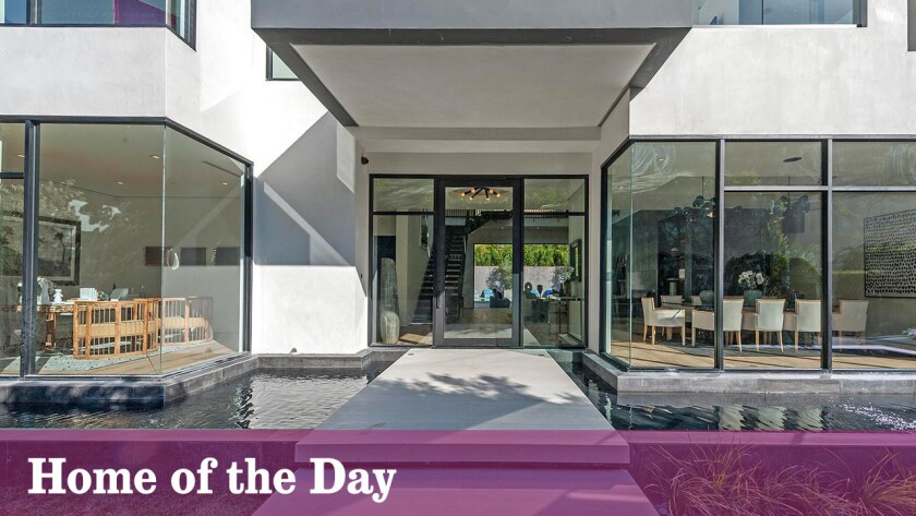 It's not a red carpet, but the Beverly Hills home does have a grand entrance.