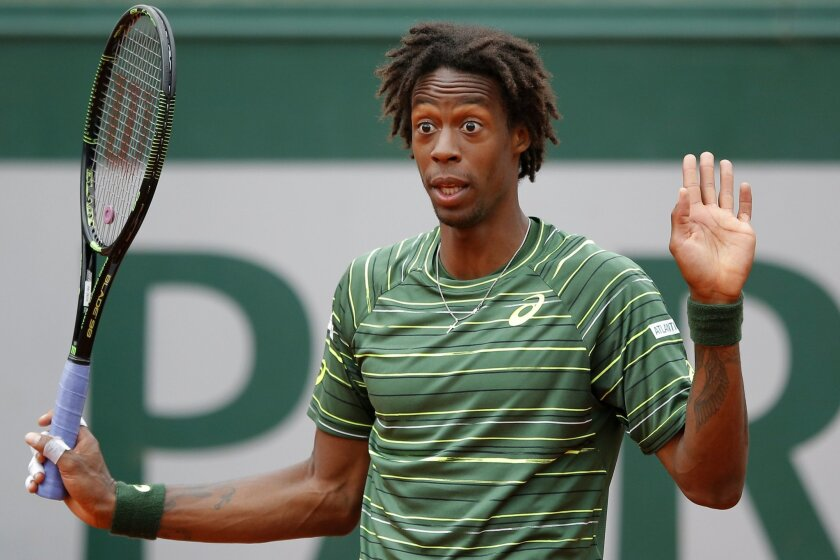 France's Gael Monfils gestures in his third round match of the French Open tennis tournament against Uruguay's Pablo Cuevas at the Roland Garros stadium, in Paris, France, Friday, May 29, 2015. (AP Photo/Francois Mori)