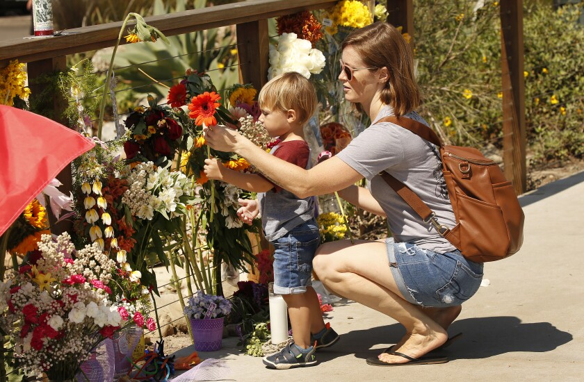 Britany Martin and son Theo, 2, at a memorial for boat fire victims in Santa Barbara Harbor