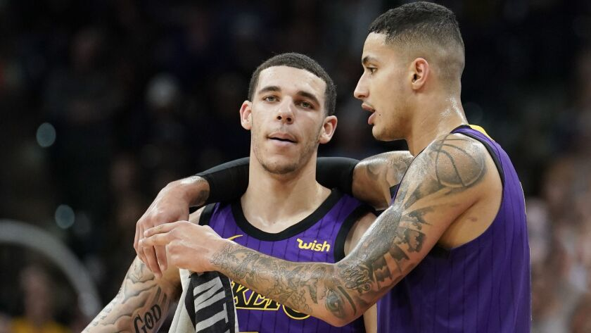 Los Angeles Lakers' Lonzo Ball, left, and Kyle Kuzma talk during a time out in the second half of an