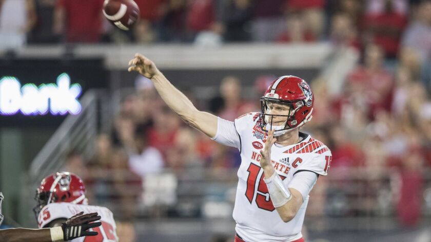 North Carolina State quarterback Ryan Finley (15) throws a pass against Texas A&M during the first h