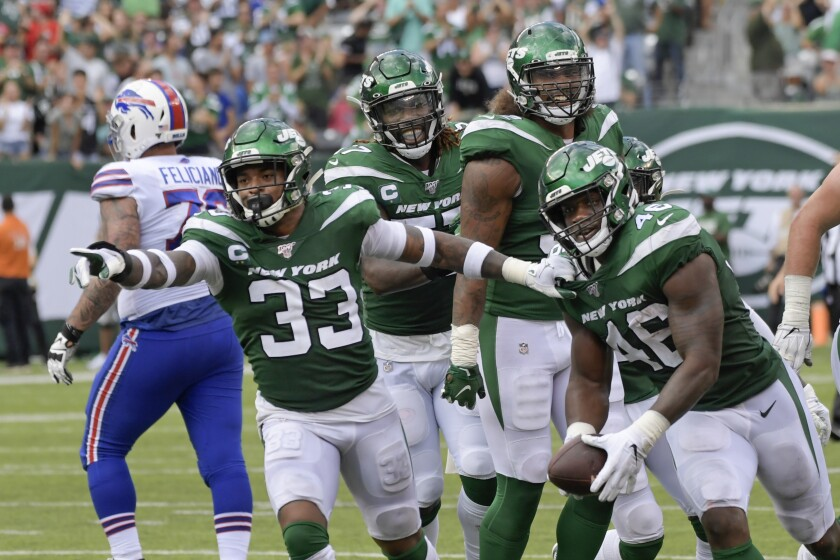New York Jets' Neville Hewitt (46) and Jamal Adams (33) celebrate with teammates after Neville Hewitt intercepted a pass during the first half of an NFL football game against the Buffalo Bills Sunday, Sept. 8, 2019, in East Rutherford, N.J. (AP Photo/Bill Kostroun)