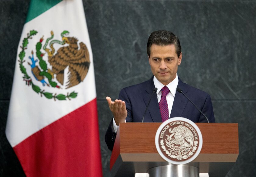 In this Aug. 27 photo, Mexico's President Enrique Pena Nieto speaks during a news conference to announce Cabinet changes.