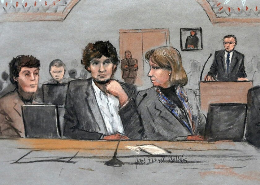 FILE - In this March 5, 2015 file courtroom sketch, Dzhokhar Tsarnaev, center, is depicted between defense attorneys Miriam Conrad, left, and Judy Clarke, right, during his federal death penalty trial in Boston. (AP Photo/Jane Flavell Collins, File)