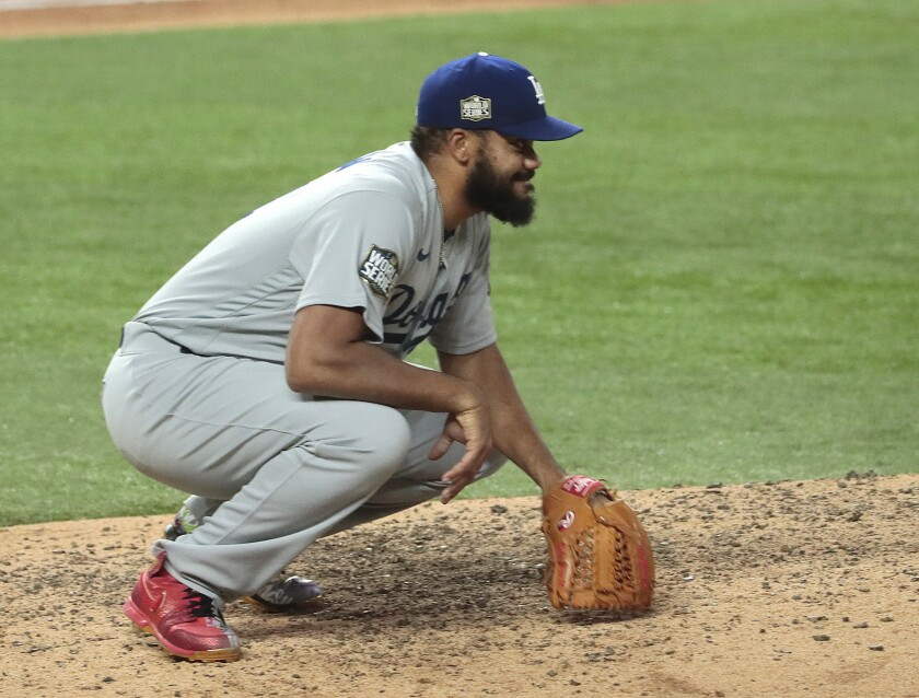 Dodgers relief pitcher Kenley Jansen reacts after giving up a home run to Tampa Bay's Brett Phillips.
