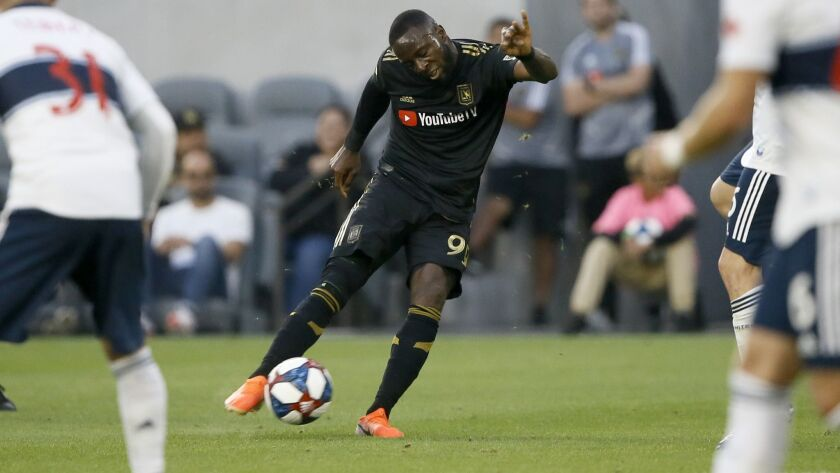 Los Angeles FC forward Adama Diomand takes a shot against the Vancouver Whitecaps during the first h