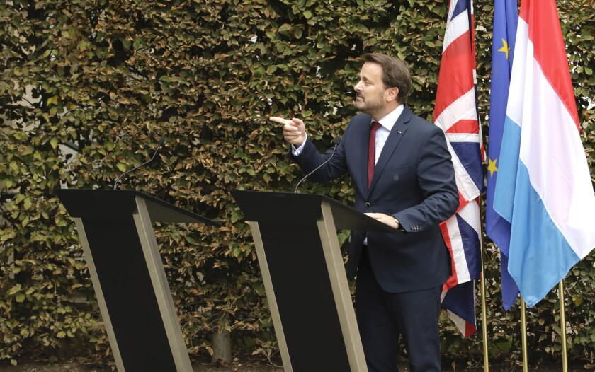 Prime Minister Xavier Bettel of Luxembourg addresses a news conference next to an empty lectern intended for British Prime Minister Boris Johnson after a meeting at the prime minister's office in Luxembourg on Sept. 16, 2019.