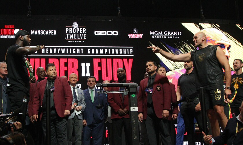 Deontay Wilder and Tyson Fury face off during their official weigh-in at the MGM Grand Las Vegas.
