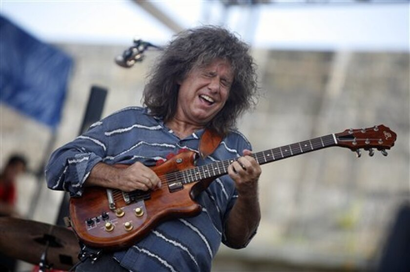 """FILE - In this Aug. 4, 2012 file photo, Pat Metheny performs at the Newport Jazz Festival in Newport, R.I. The word """"conventional"""" simply doesn't exist in Pat Metheny's musical lexicon. The guitarist has never been complacent, choosing to follow an unpredictable path. (AP Photo/Joe Giblin, File)"""