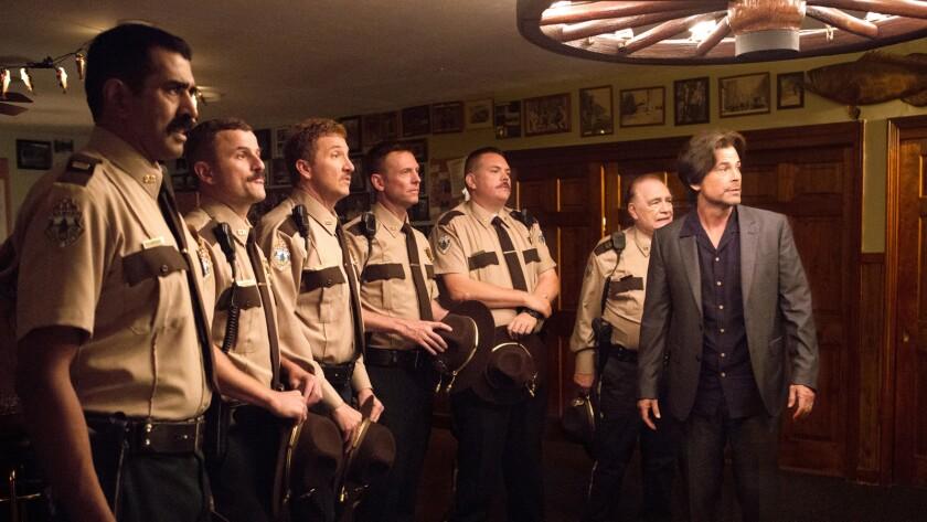 "Jay Chandrasekhar, from left, Steve Lemme, Paul Soter, Erik Stolhanske, Kevin Heffernan, Brian Cox and Rob Lowe in ""Super Troopers 2."""