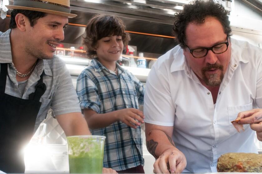 "John Leguizamo, left, Emjay Anthony and Jon Favreau star in ""Chef."""