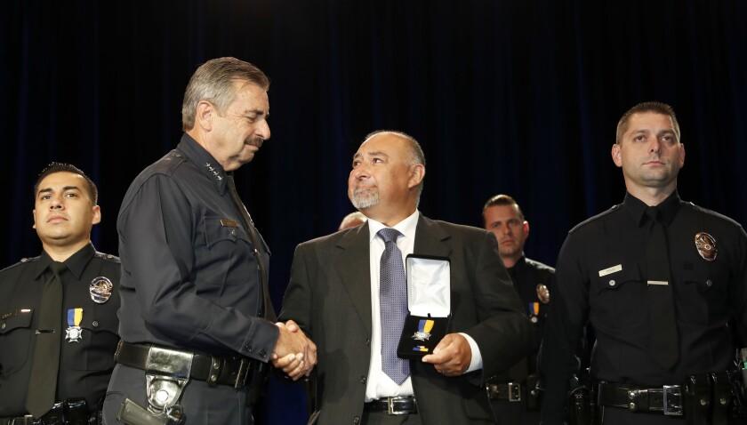 LOS ANGELES, CALIF. -- THURSDAY, SEPT. 28, 2017: Greg Monroe, center, father of LAPD officer Heat