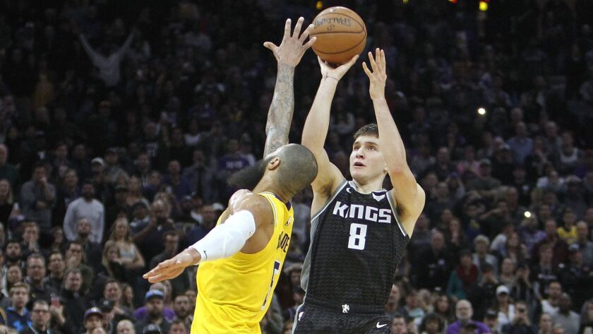 Sacramento Kings guard Bogdan Bogdanovic (8) hits a three-point shot over Lakers center Tyson Chandler (5) at the buzzer.