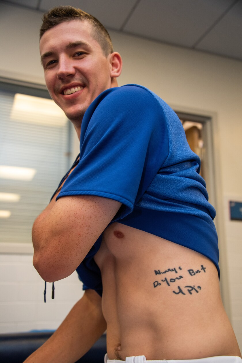 Walker Buehler shows off his tattoo