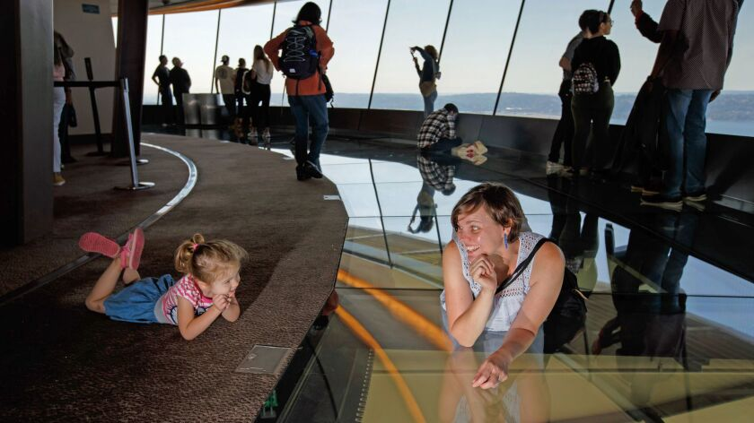 SEATTLE, WASH. -- TUESDAY, SEPTEMBER 4, 2018: Shauna Bittle lays on the rotating glass floor and tri