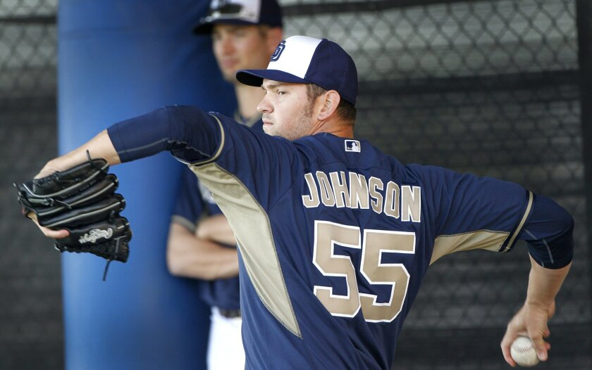 Padres pitcher Josh Johnson works on his pitches as the second day of spring training began for the Padres with pitchers and catchers.