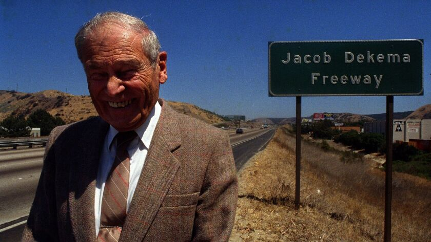 Jacob Dekema stands by the sign that designates Interstate 805 in his honor on July 3, 1987.