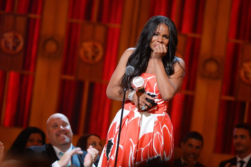 Audra McDonald accepting the award for performance by an actress in a leading role in a play during the 68th annual Tony Awards.