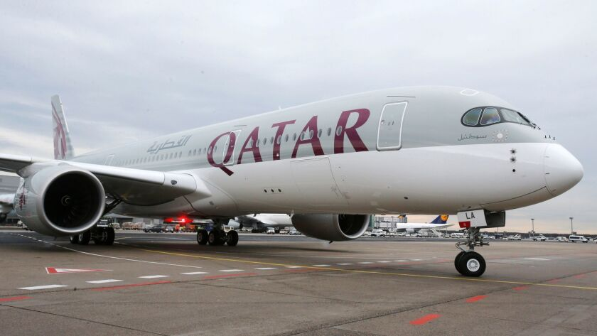FILE - In this Jan. 15, 2015, file photo, a new Qatar Airways Airbus A350 approaches the gate at the