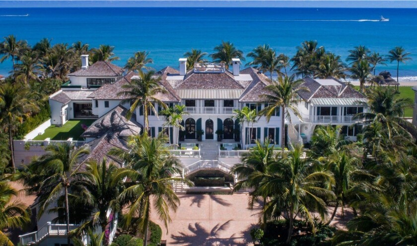 Spanning 25,000 square feet, the 11-bedroom home expands to a palm-topped patio with a gazebo, cabana, custom swimming pool and spa.