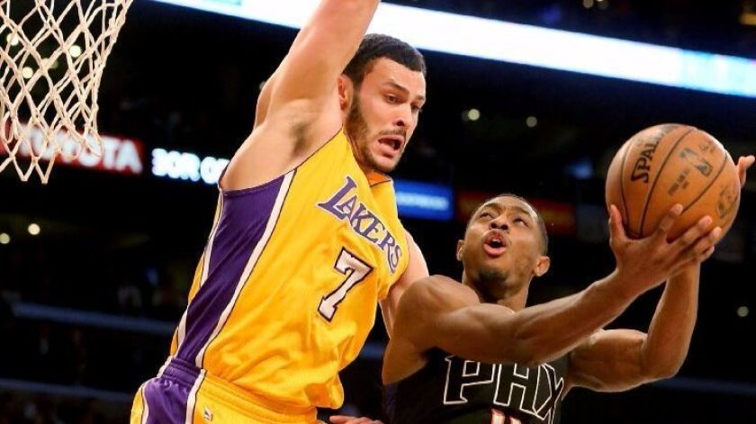 Lakers forward Larry Nance Jr. defends against Suns guard Brandon Knight during the first quarter of a game on Dec. 9.