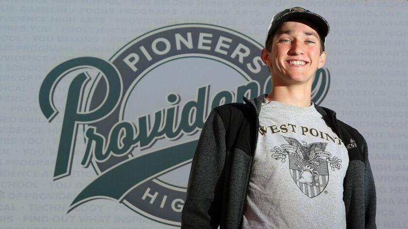 Providence High School graduating senior Conrad Davis, wearing a West Point tee shirt, sweat shirt,