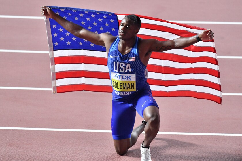 Christian Coleman, of the United States, poses after winning the men's 100 meter race during the World Athletics Championships in Doha, Qatar, Saturday, Sept. 28, 2019. (AP Photo/Martin Meissner)