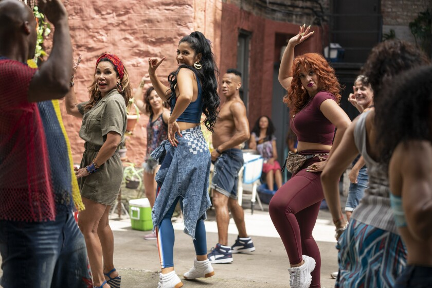 A group of women dancing in the street.