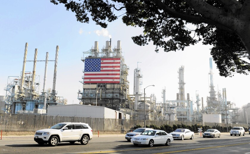 In May alone, the state's fuel-making companies took in a record high of $1.17 a gallon at the refinery level, a report said. Above, the Tesoro petroleum refinery in Carson.