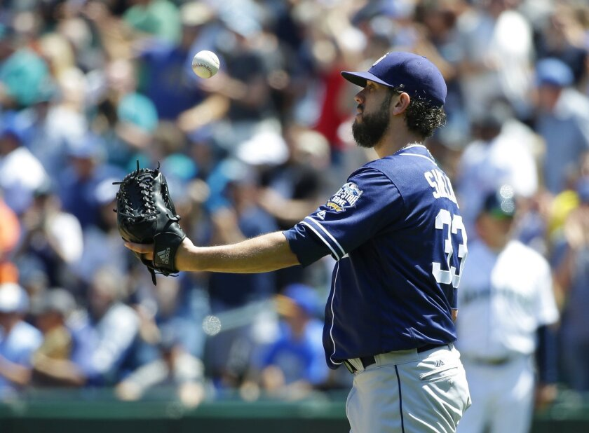 San Diego Padres starting pitcher James Shields tosses the ball after giving up a three-run home run to Seattle Mariners' Seth Smith in the third inning of a baseball game, Tuesday, May 31, 2016, in Seattle. (AP Photo/Ted S. Warren)