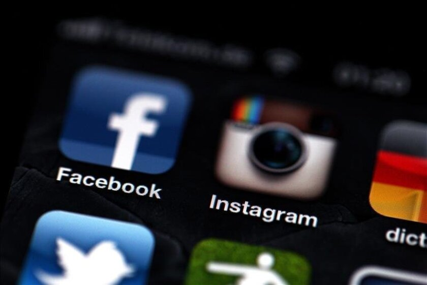 Facebook, Instagram and Twitter icons on an iPhone.