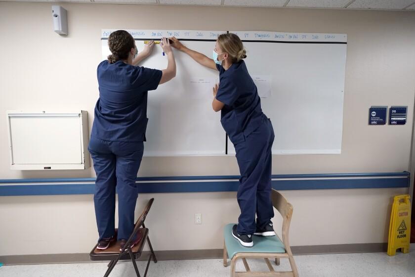 Nurses set up a patient board