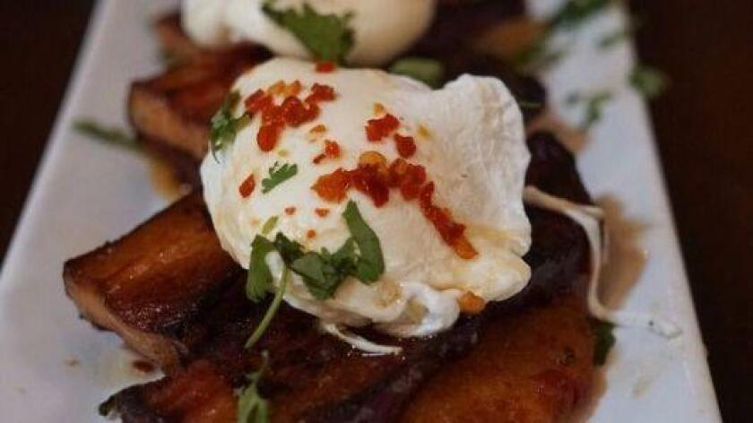Pork belly Benedict is the #1 dish at Werewolf, Yelp's #1 most popular restaurant to make a reservation in San Diego. The dish is a twist on the classic, subbing potato cakes for English muffins, pork belly for Canadian bacon and a topping of citrus maple glaze. (Courtesy photo