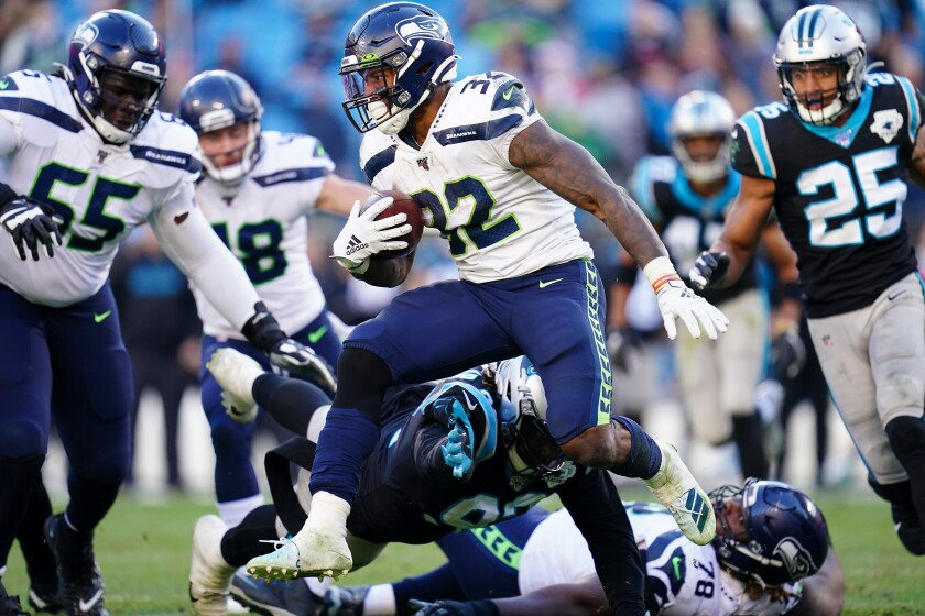 Seattle Seahawks running back Chris Carson runs with the ball against the Carolina Panthers on Sunday.