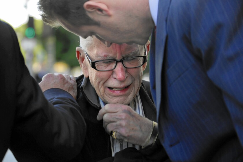 Brian Newt Beaird's father, Bill, weeps at a news conference in front of LAPD headquarters. The city paid $5 million to settle the family's lawsuit.