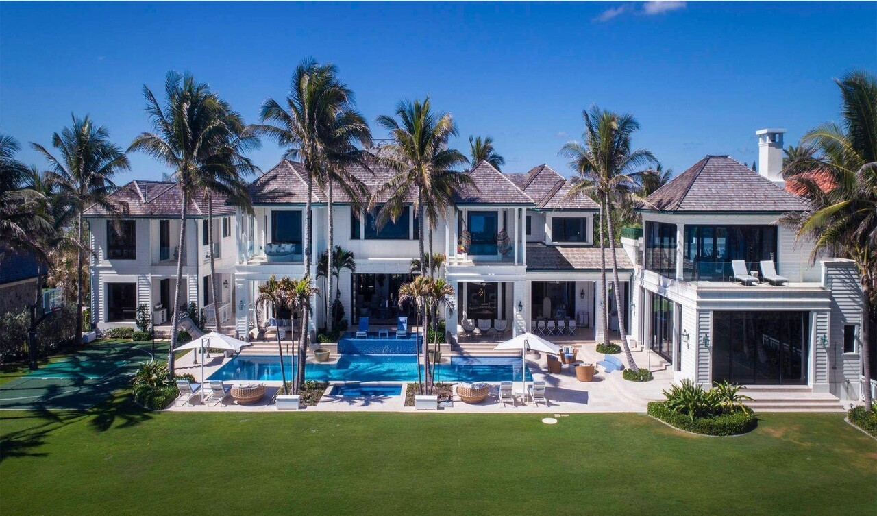 The 1.4-acre estate centers on a nearly 26,000-square-foot mansion with 11 bedrooms and 18 bathrooms.