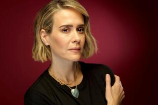 Sarah Paulson says, 'It was like I had a neck brace,' of her first acting job