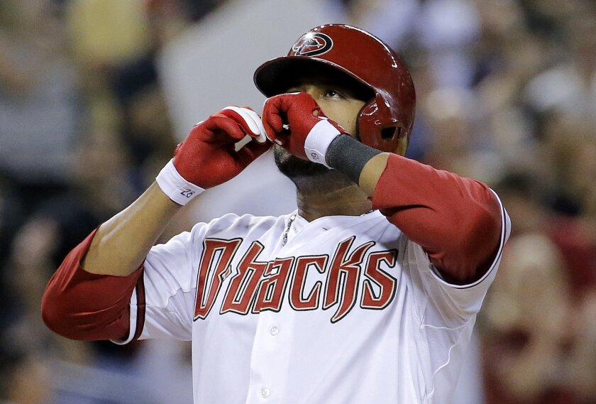 Arizona Diamondbacks' Andy Marte celebrates his two run home run against the Pittsburgh Pirates during the sixth inning of a baseball game, Thursday, July 31, 2014, in Phoenix. (AP Photo/Matt York)