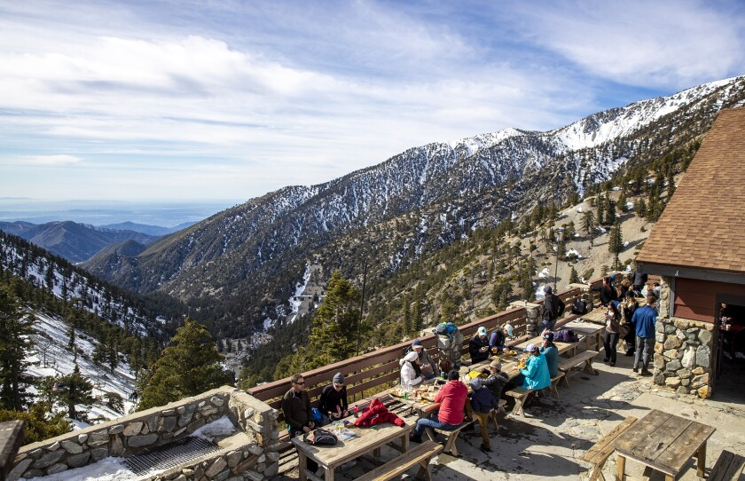 A Jan. 2020 photo shows people enjoying the view at The Notch at Mt. Baldy ski resort in Mt. Baldy.