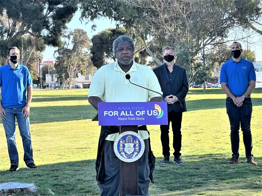 Formerly homeless man Mickey Major speaks during a press conference at North Park Community Park.