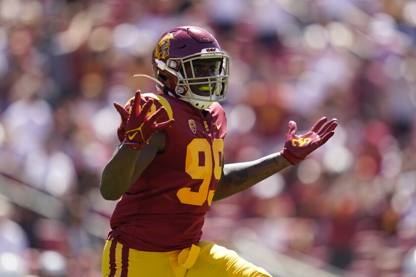 Southern California linebacker Drake Jackson (99) celebrates after catching an interception during the first half of an NCAA college football game against San Jose State Saturday, Sept. 4, 2021, in Los Angeles. (AP Photo/Ashley Landis)
