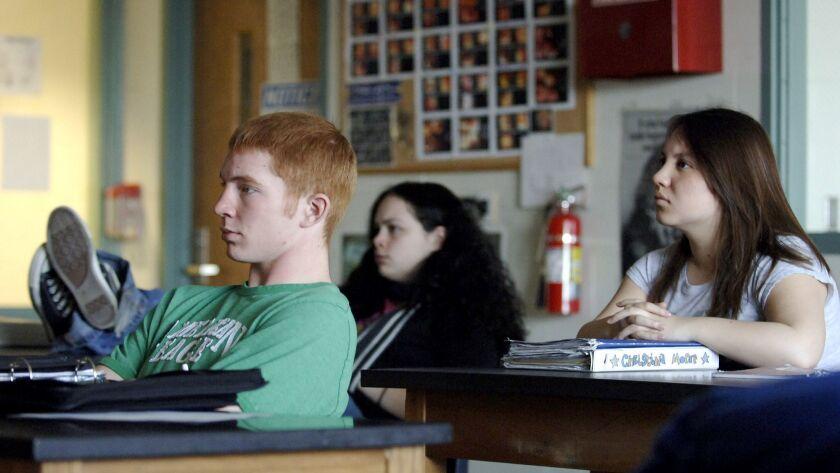 LIBERTY, MISSOURI––03/15/06: Liberty High School students Chris Willett, left, Melissa Brooks, middl