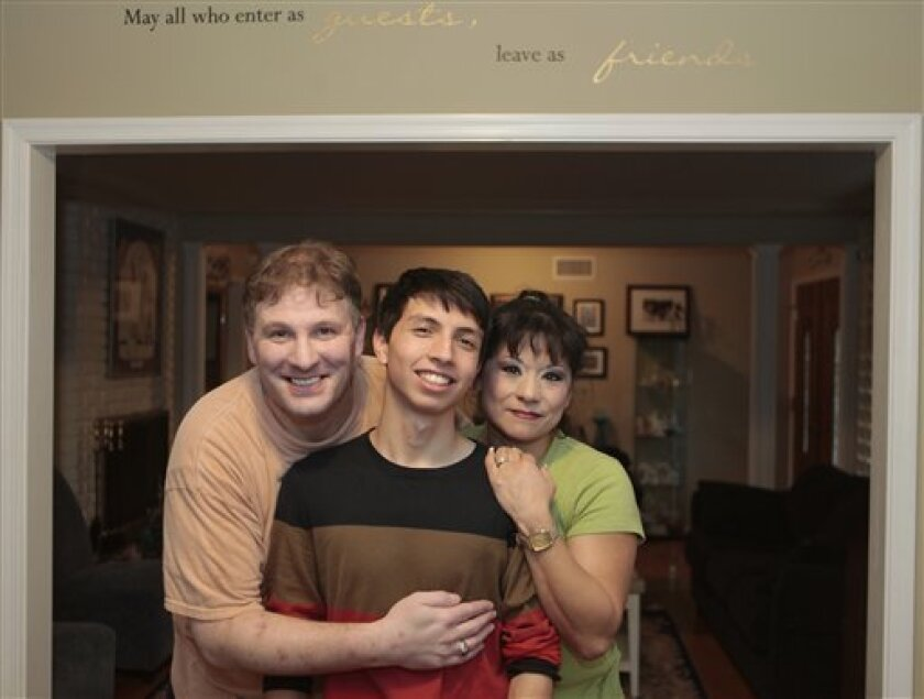 This Friday, Oct. 8, 2010 photo shows high school senior student Isaiah Baiseri, middle, as he poses for a photo with his parents Russell, left, and Yvette Baiseri at their home in Glendora, Calif. Baiseri heads a gay-straight alliance group at his high school. Baiseri says he started to realize he